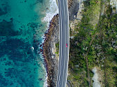 Aerial photograph of a car driving through the Sea Cliff Bridge, New South Wales
