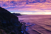 istock Sea Cliff Bridge on sunrise  in purple and pink light 612385690