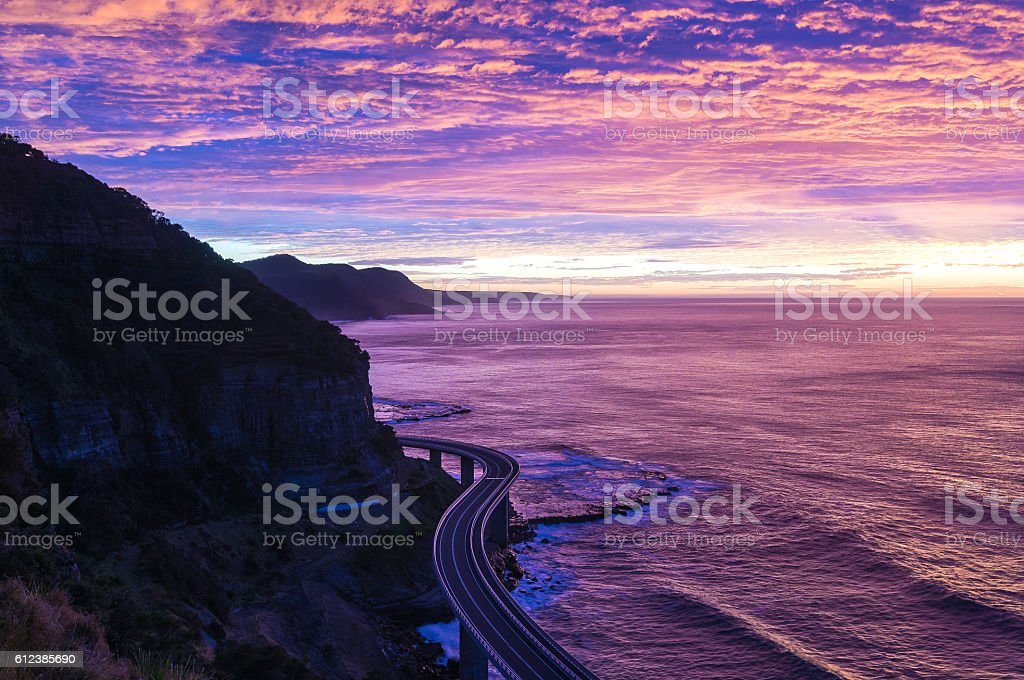 Sea Cliff Bridge on sunrise  in purple and pink light stock photo