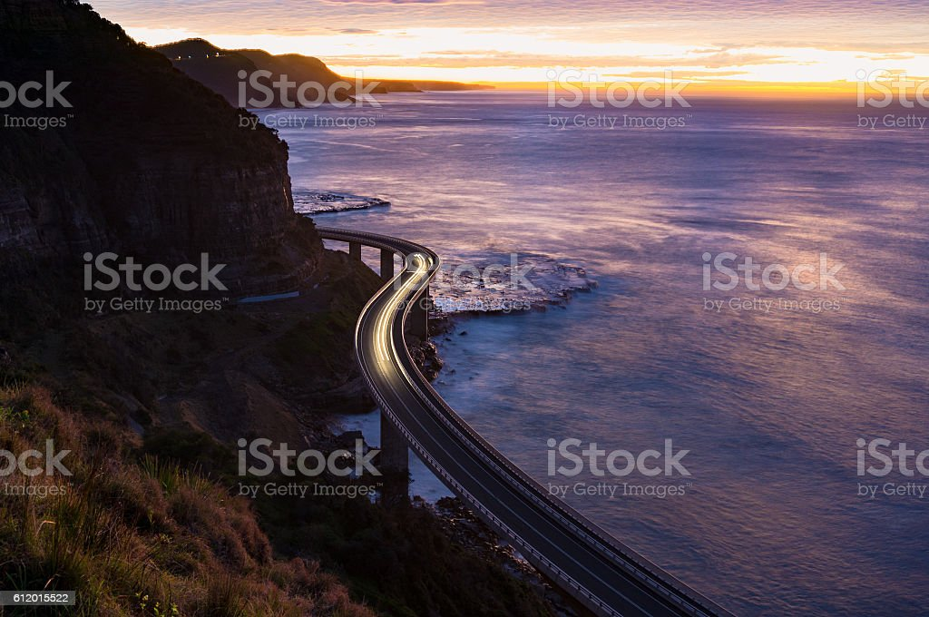 Sea Cliff Bridge on sunrise with moving traffic stock photo
