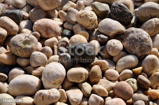Round colorful pebble stones background