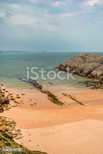 Landscape of a cove on the beach with rocks and sand