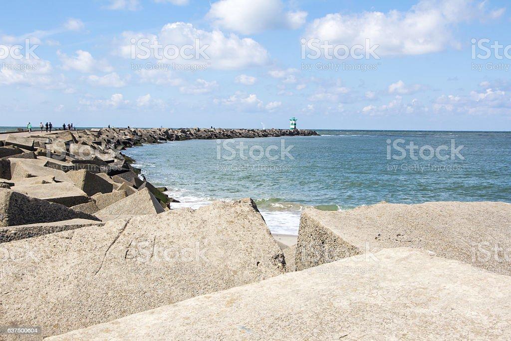 Sea dike with square blocks stock photo