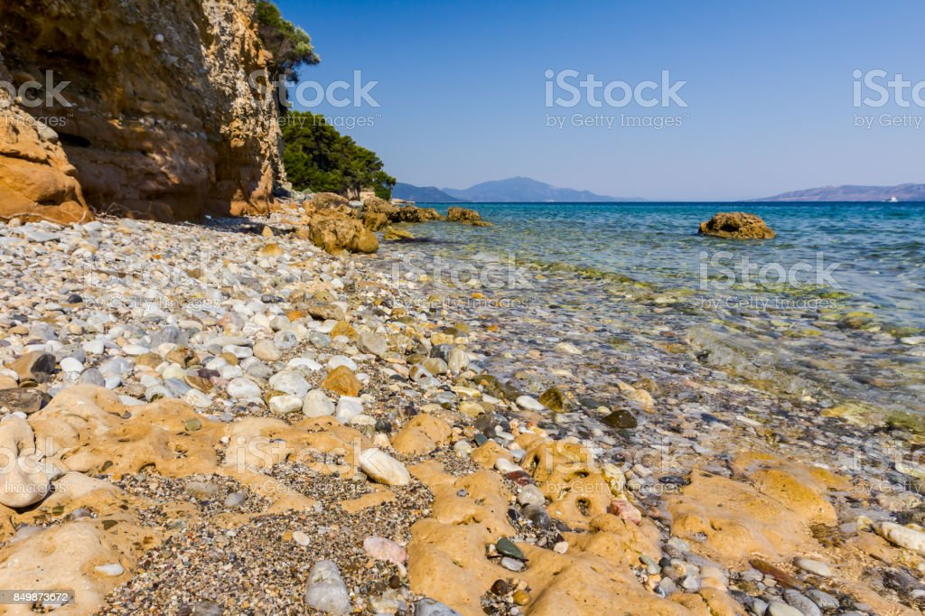 Sea erosion of rugged cliffs on rocky coastline stock photo