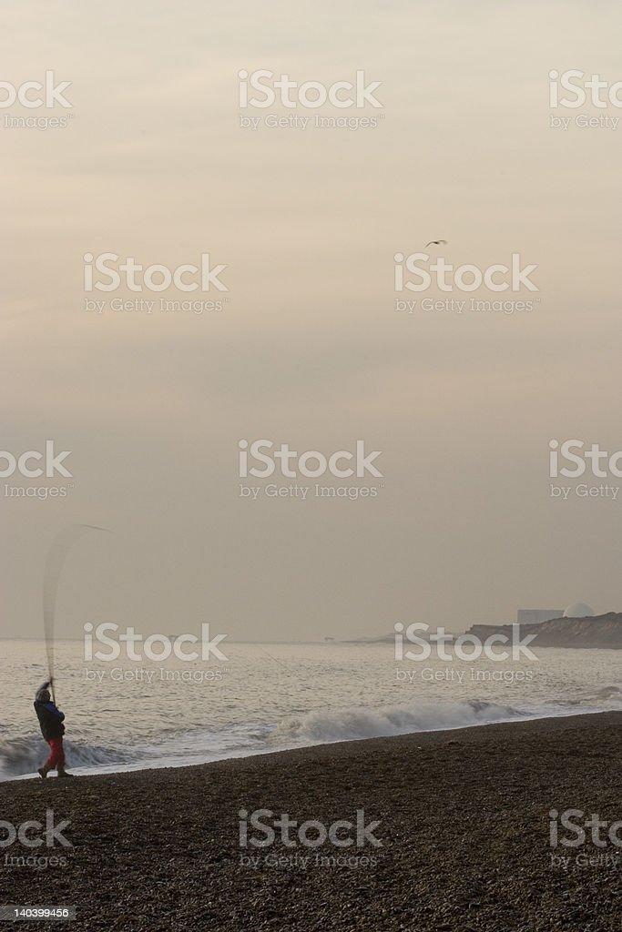 sea fisherman mid cast royalty-free stock photo