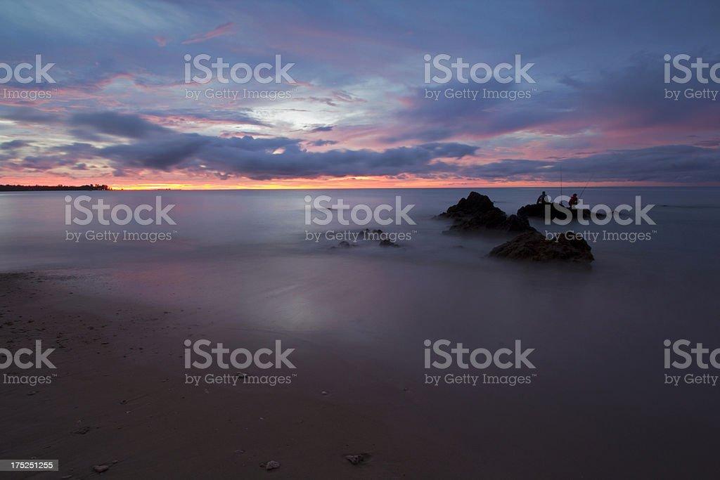 Sea fishing at dusk royalty-free stock photo