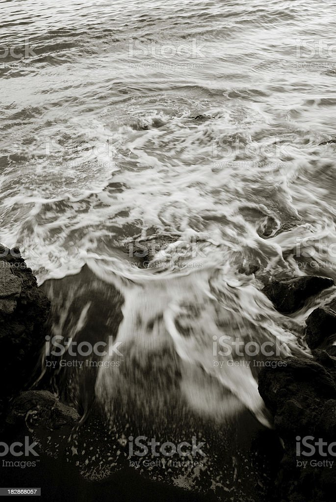 sea foam in black and white royalty-free stock photo
