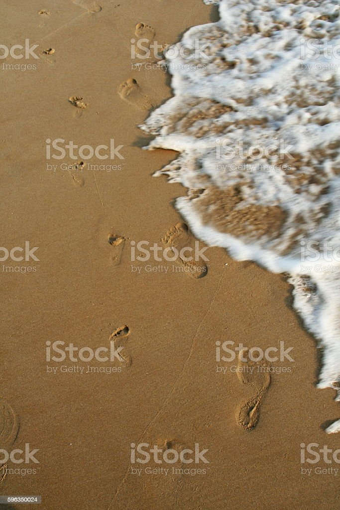 Sea foam waves on the beach royalty-free stock photo