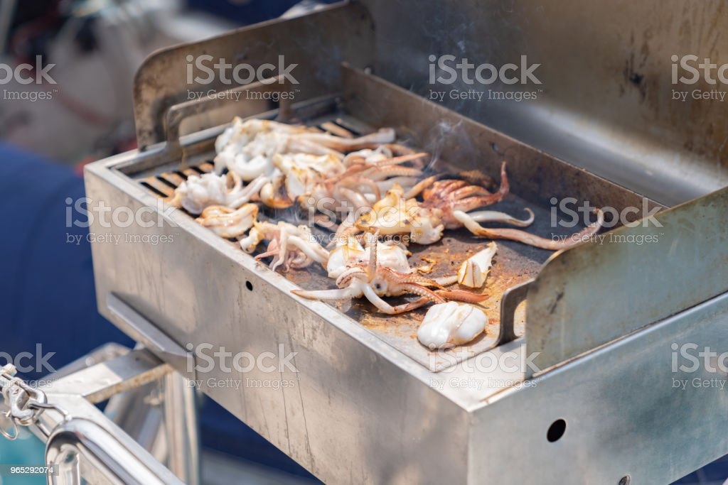 Sea food is squid barbecue cooking on luxury yacht. royalty-free stock photo