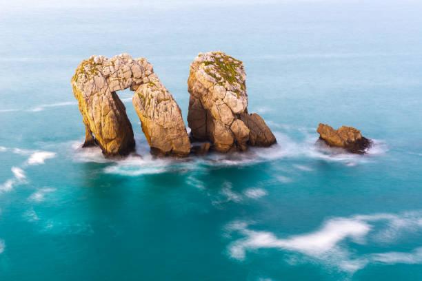 Sea Gate (or Canto del Diablo) at Broken coast, Liencres in Cantabria Spain stock photo