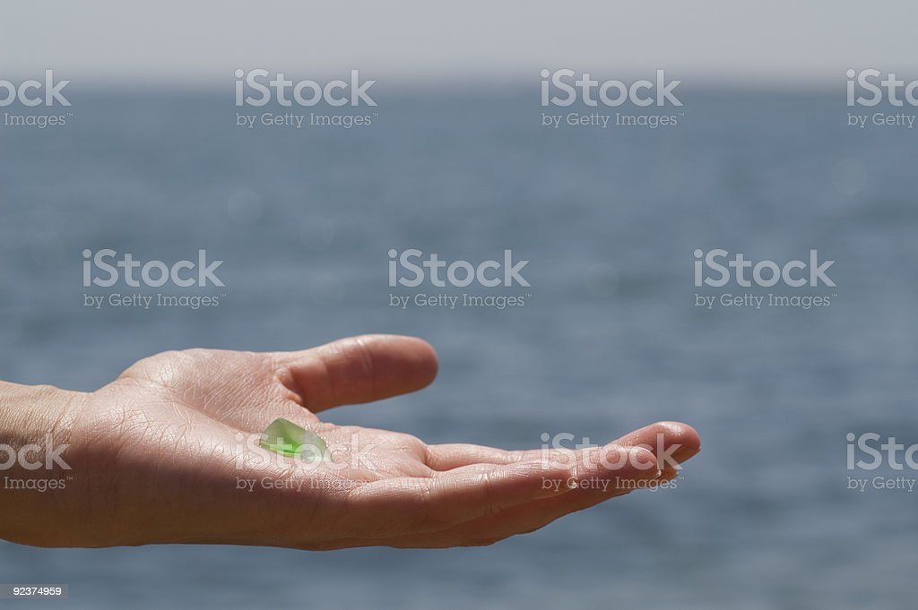 Sea glass on a hand royalty-free stock photo