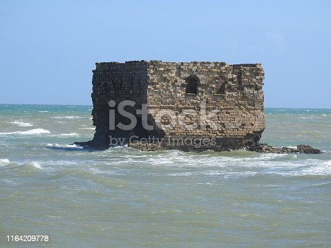 Casa Del Mar. The Atlantic ocean, the Cape Juby, Morocco. The ruined fortress, a tide, sand beach ,sea house .