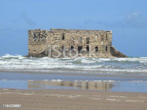 Casa Del Mar. The Atlantic ocean, the Cape Juby, Morocco. The ruined fortress, a tide, sand beach ,sea house .