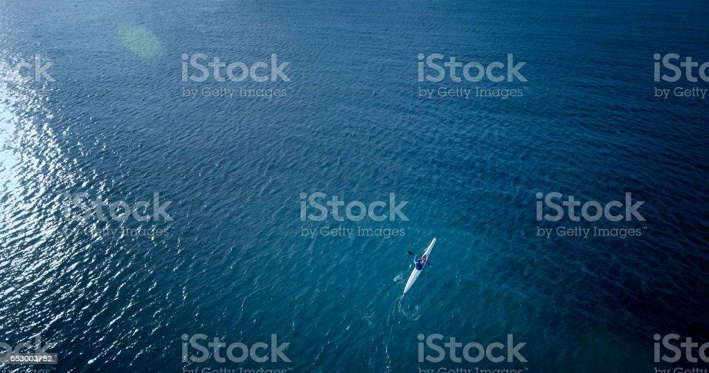 Sea kayak in the open sea stock photo