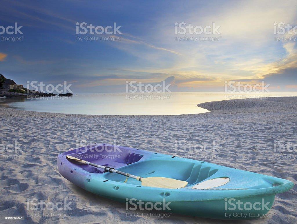sea kayak on sand beach royalty-free stock photo