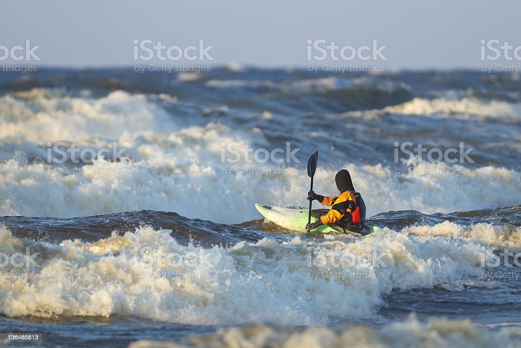 Sea kayak on waves stock photo