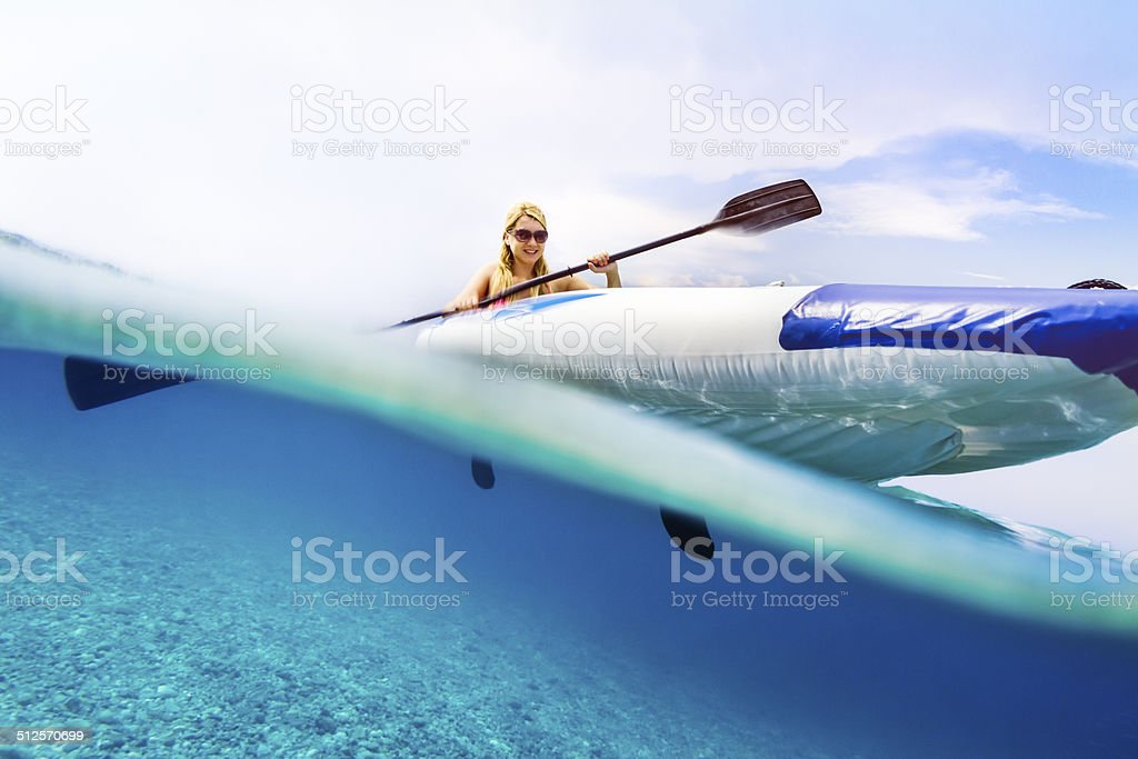 Sea kayaking with underwater and seabed visible stock photo