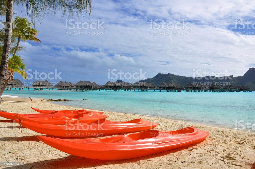 Sea Kayaks Drawn up on a Beach royalty-free stock photo