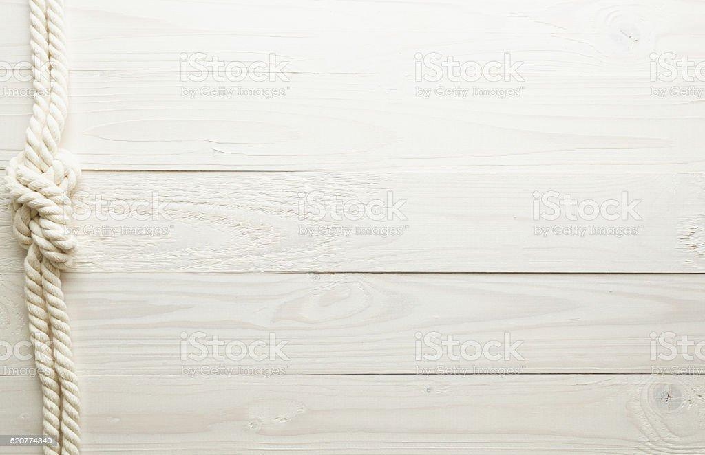 Nó do mar sobre fundo de madeira branco - foto de acervo