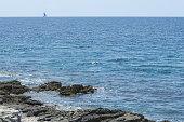 Wavy Blue Sea Rock Land and Sailor Boat Minimal