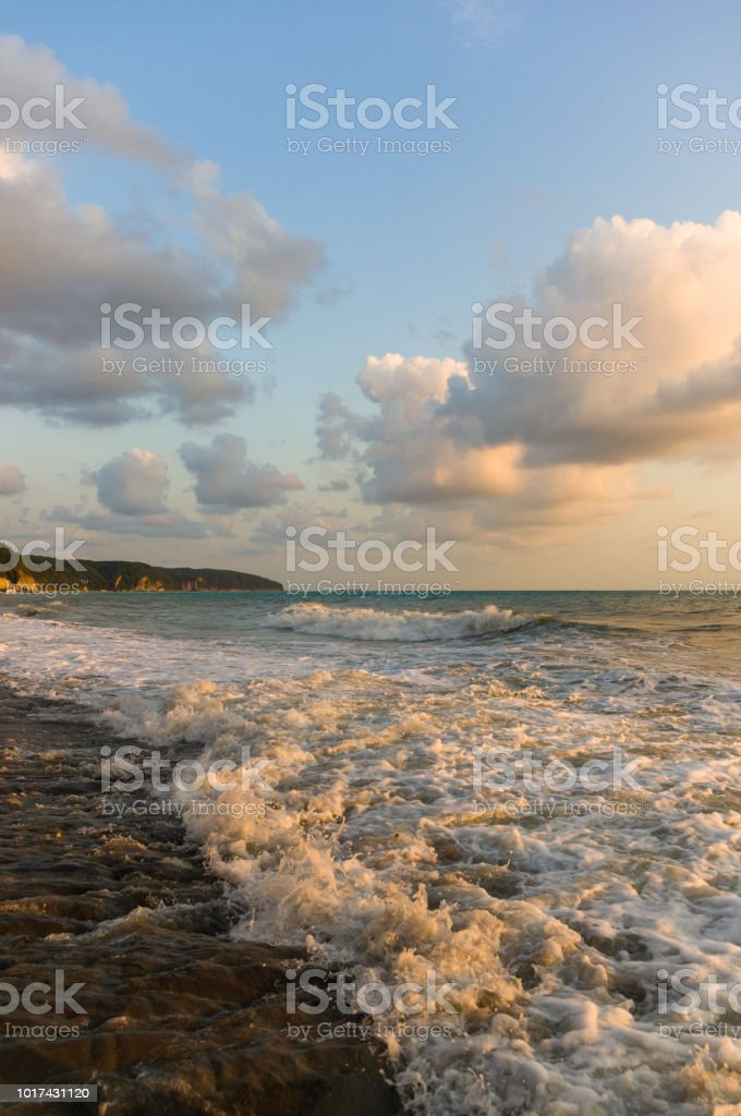 Sea Landscape Is A Pebbly Beach With Waves In White Foam