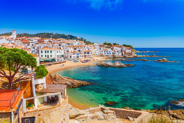 Sea landscape with Calella de Palafrugell, Catalonia, Spain near of Barcelona. Scenic fisherman village with nice sand beach and clear blue water in nice bay. Famous tourist destination in Costa Brava Sea landscape with Calella de Palafrugell, Catalonia, Spain near of Barcelona. Scenic fisherman village with nice sand beach and clear blue water in nice bay. Famous tourist destination in Costa Brava spain stock pictures, royalty-free photos & images