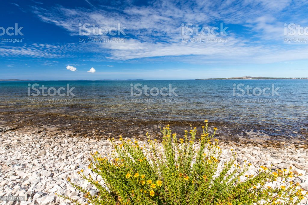 Sea landscape with islands on background. stock photo