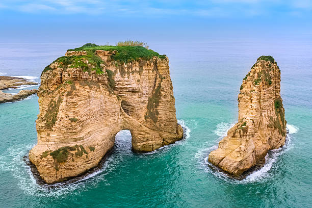 Sea Landscape with Pigeons Rock Beirut Lebanon Photo of the The Pigeons' Rock rock formation and the Mediterranean Sea in Beirut, Lebanon. beirut stock pictures, royalty-free photos & images
