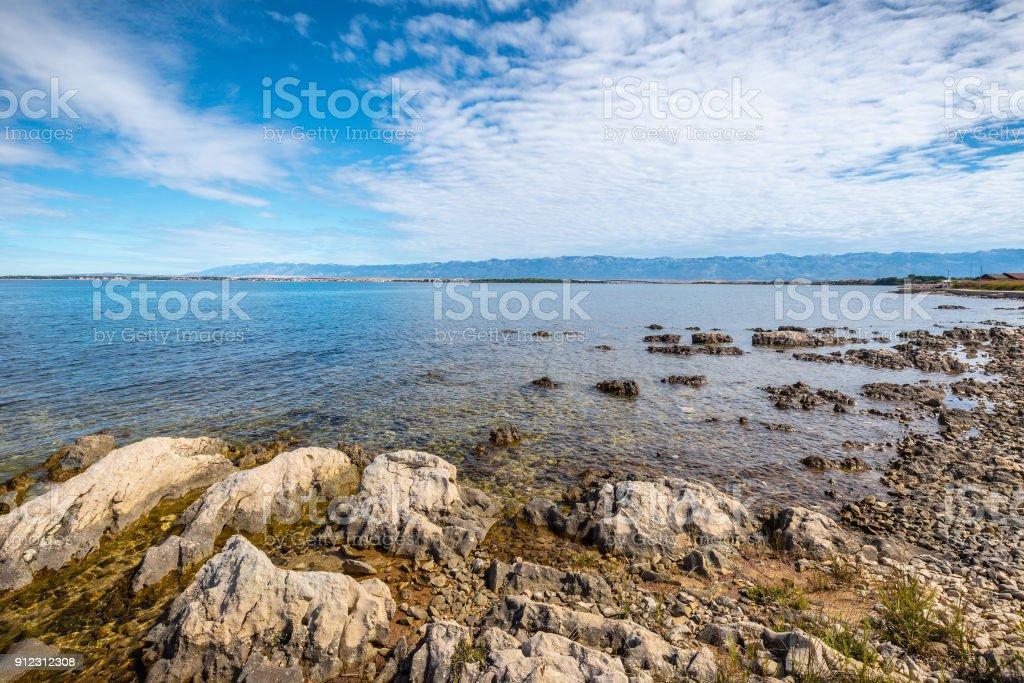 Sea landscape with the Velebit Mountains on background. stock photo