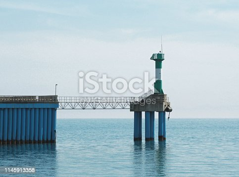 Panoramic view of of sea pier with lighthouse tower