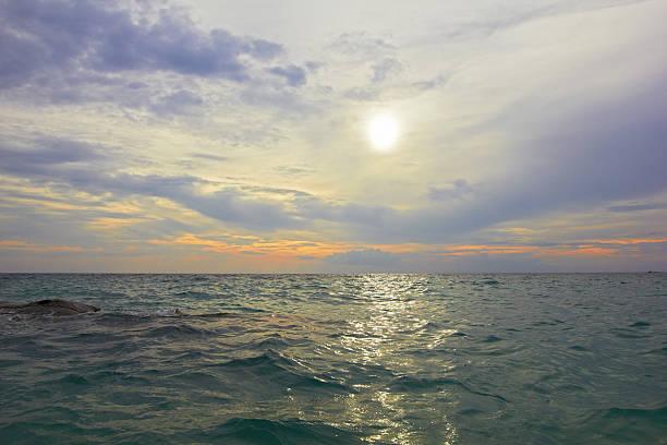 Sea ocean landscape - water waves, sun, clouds sky stock photo