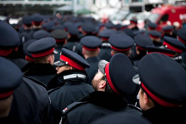 Sea of Blue Police Hats, Officer Looking Upward stock photo