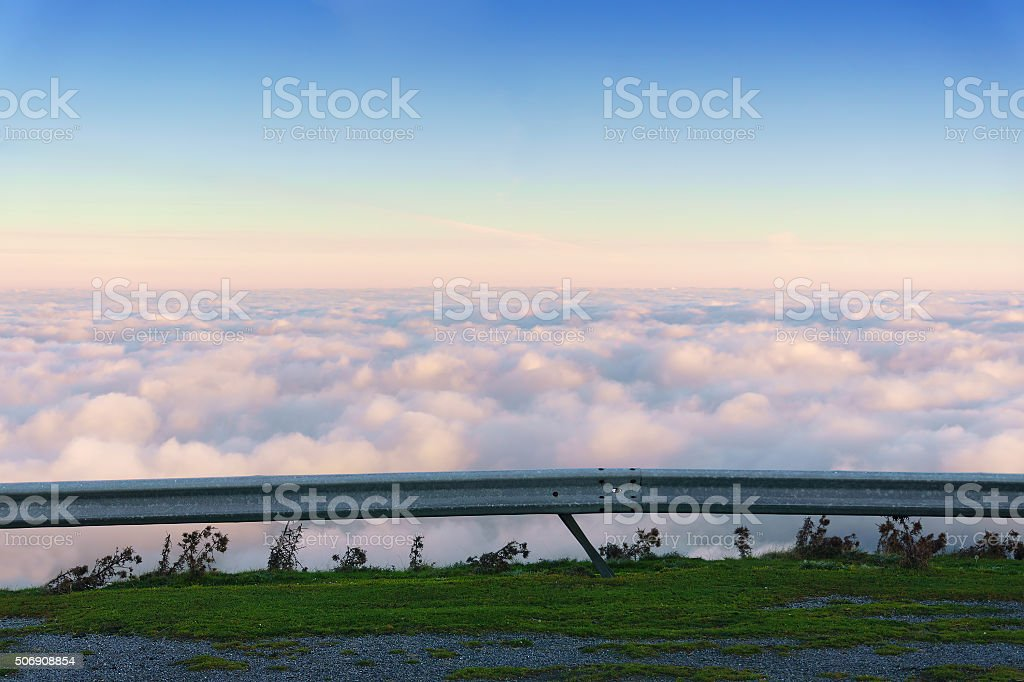 sea of clouds from traffic barrier stock photo