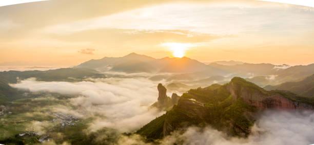 Sea of clouds sunrise stock photo