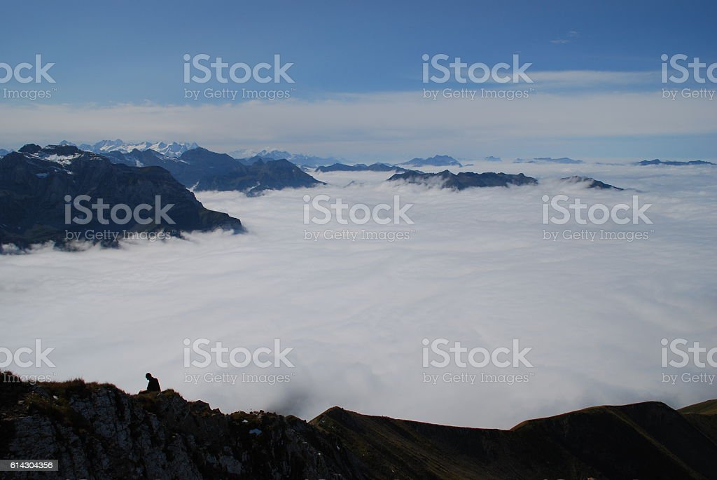 Sea of fog and hiker Swiss mountains stock photo