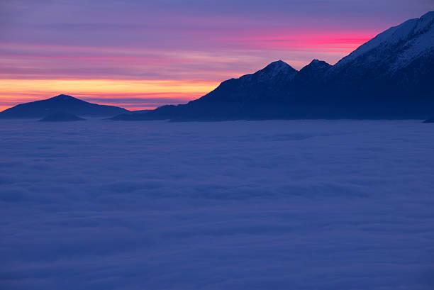 Sea of fog over an alpine lake stock photo