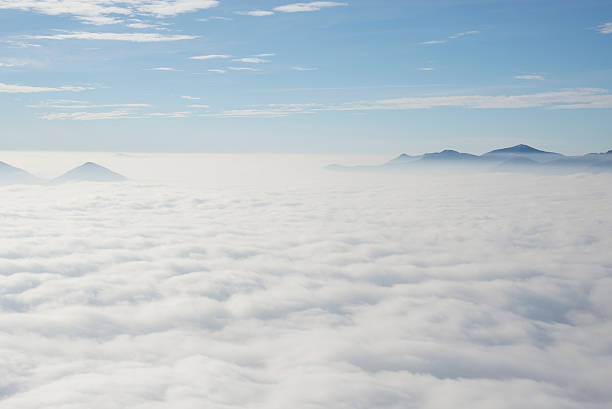 Sea of fog over an alpine lake stock photo