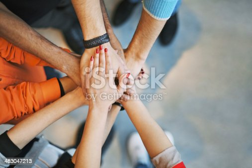 istock Sea of hands showing unity and teamwork 483047213