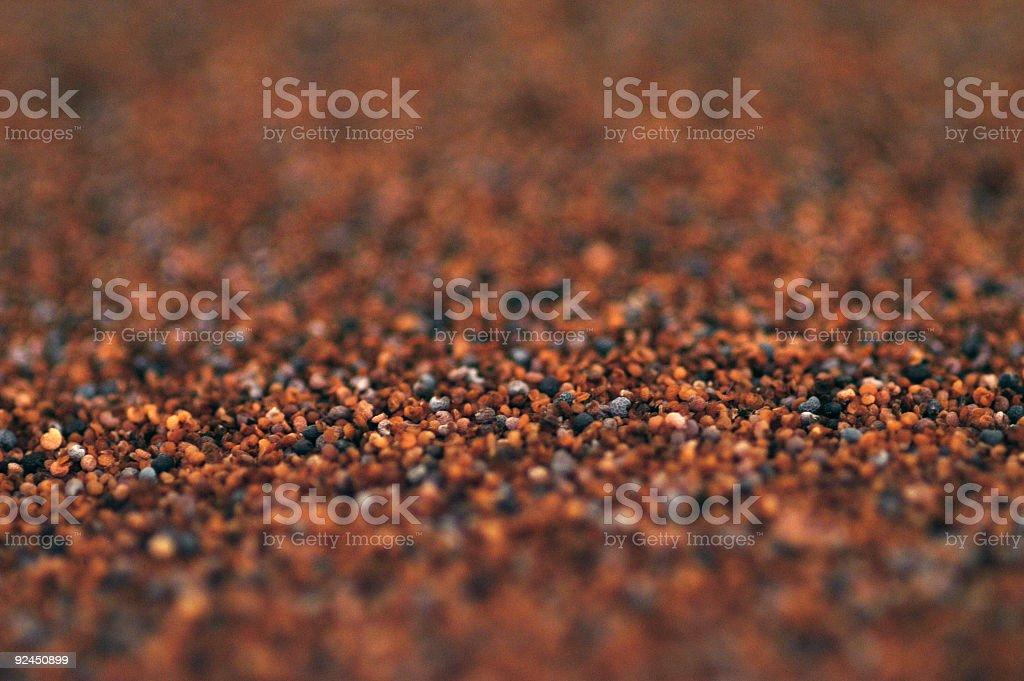 Sea of poppy seeds stock photo