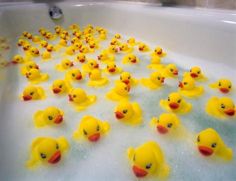 Sea of toy ducks in the bathtube