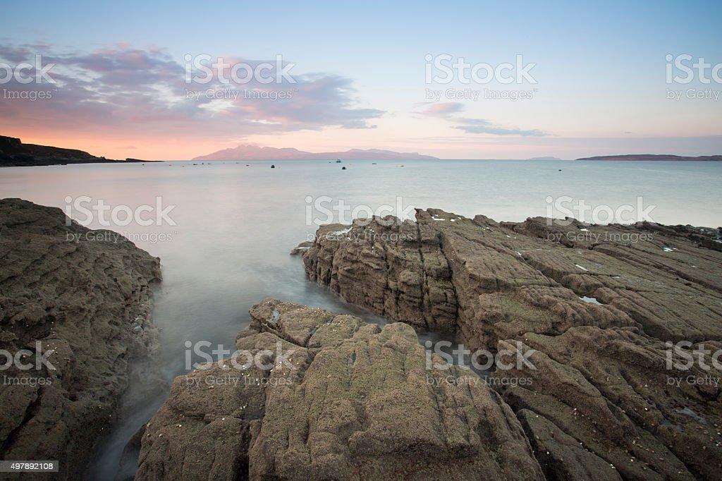 sea on the shore of scotland  at sunrise stock photo