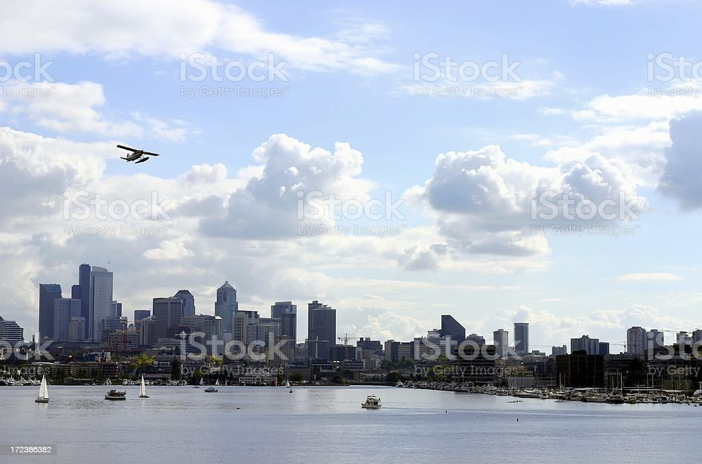 Sea Plane Over Lake Union and the Seattle Skyline stock photo