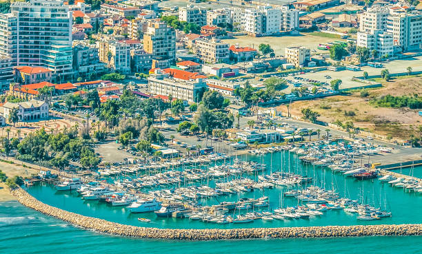 sea port city of larnaca, cyprus. view from the aircraft to the coastline, beaches, seaport and the architecture of the city of larnaca. - cyprus стоковые фото и изображения