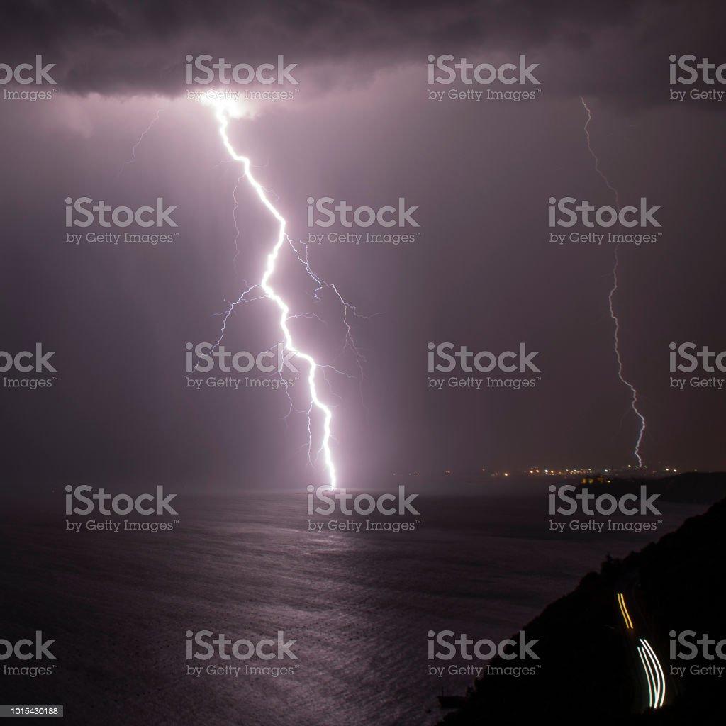 Sea Road Storm Lightning Night stock photo