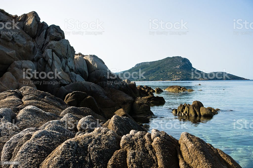 Sea rocks on a beach at summer morning in Sithonia stock photo