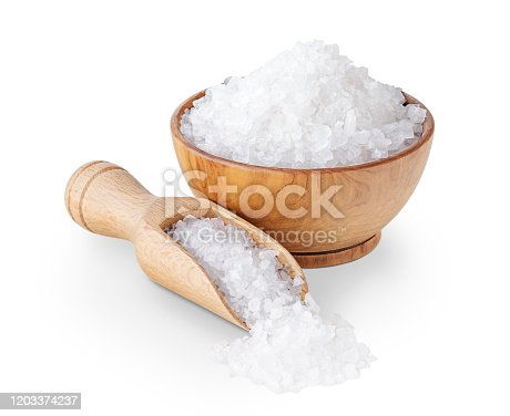 Sea salt crystals in a wooden bowl isolated on white background