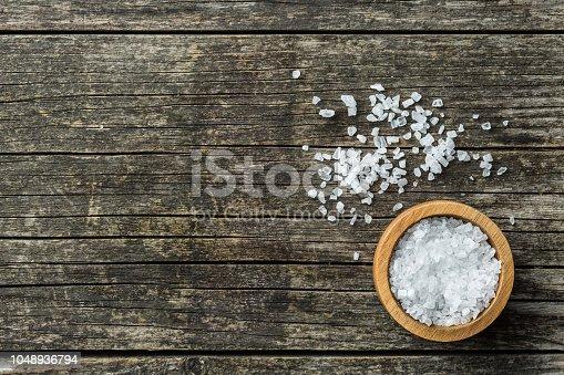 Sea salt in bowl. Top view.
