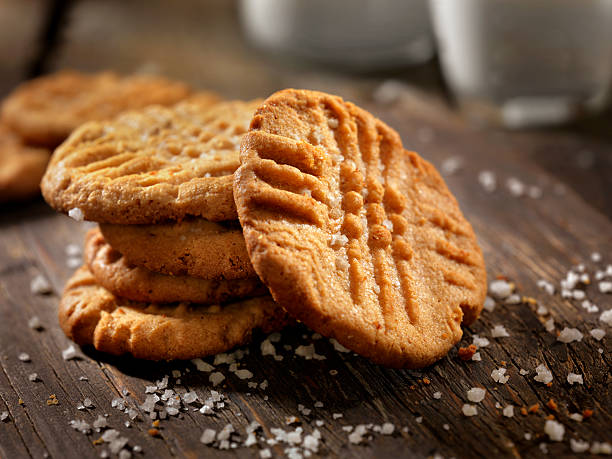 sea salt peanut butter cookies with milk - bakplåt bildbanksfoton och bilder