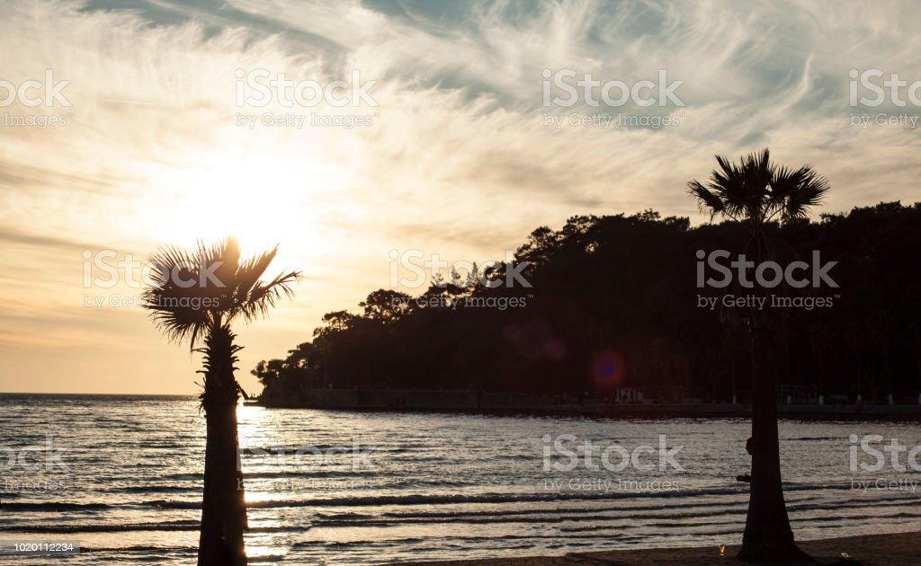 Deniz, kum ve güneş (gün batımı) stok fotoğrafı
