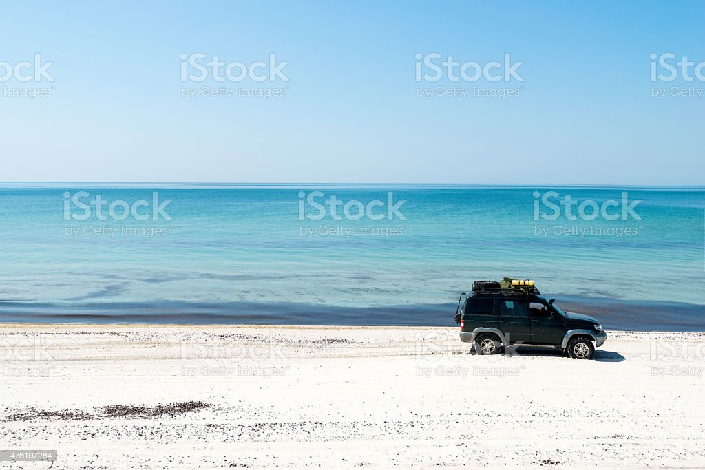 Sea sand cars stock photo